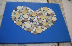 'Homemade' by *twinkelke*. Knopen in hartjesvorm op een canvasdoek in helderblauwe kleur. € 15. Te bestellen, niet in voorraad.