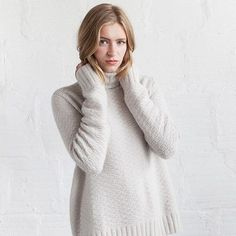 The simple textured stitch pattern plays to the strength of Woolfolk's chainette worsted weight yarn in Løs, designed by Ashley Yousling. This simple and appealing turtleneck pullover features straight clean lines and side vents for a comfortable fit.