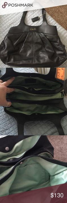 Authentic Leather Coach purse. Purse is gently used (for about a month).   Tons of storage  compartments with a zipper in the middle. Black leather exterior with a mint green interior.  Tried to capture any flaws in pics. Coach Bags Shoulder Bags