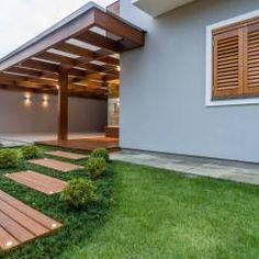 Casa em Taquara/RS: Garagens e edículas Moderno por Plena Madeiras Nobres