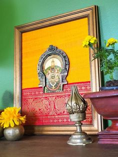 This beautiful prabhavali frame is made with gold foil ammavaru and is adorned with pure raw silk and kanchipuram silk trim. This frame becomes a lovely addition to your ethnic home decor with traditional colors. Craft Room Decor, Home Decor Vases, Home Decor Wall Art, Home Decor Furniture, Art Decor, Indian Room Decor, Ethnic Home Decor, Indian Home Interior, Indian Interiors