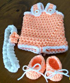 Your doll is ready for some summertime play in this peach and white romper set which includes:  1. Peach romper with white trim. Buttons secure straps over shoulders. Outfit slips on doll feet first. 2. White headband with peach flower. 3. Pair of peach shoes with white yarn ties. (Yarn ties are removable and are not required to stay on dolls feet.  ****Doll is not included****  4 Piece hand-crocheted outfit designed for your 13 inch Baby Alives New Teeth Doll by Hasbro.   Outfit is made out…