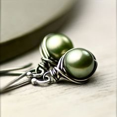 Pearl. love the green shade and wrapped wire.