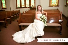 Photography by Samantha McGranahan, The Roxy Studio. Wedding photography, wedding photos, bridal portraits, white, wedding gown, flowers, church, pew
