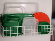 Use a spice rack on the inside of the cupboard door for lids