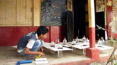 "Coca-Cola's ""Liters of Light"" program transforms plastic soda bottles into light bulbs in rural Indian schools."