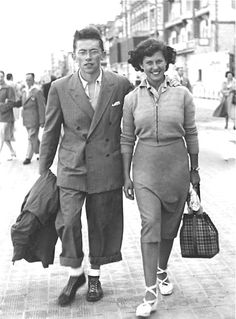 1950. A young couple who owned their own clothing shop in Brussels. One day we hope to do the same.