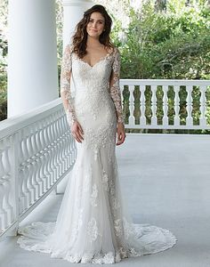 If you were not already loving the tattoo lace trend, this dress will change your mind. Cotton lace appliqués, an illusion back, godet train, Jersey lining, and hem lace combine to create this stunning look.