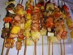 Teriyaki Steak , bar b q chicken with pineapples and Cilantro Shrimp kabobs.