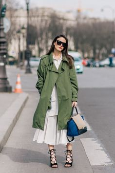 Fashion blogger Zina Charkoplia wearing Zara coat, Celine bag, Chloe shoes, Reiss skirt and ASOS sunglasses before the Chloe Fall/Winter 2015-2016 fashion show in Paris, France.