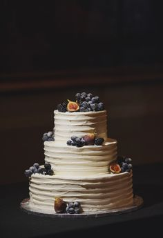 Simple three layer buttercream cake adorned with figs, grapes and berries ~ we ❤ this! moncheribridals.com