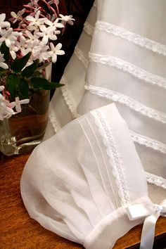 The delicate trim of a Christening. at isabelgarreton.com