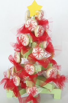 Christmas Sucker Tree - Pictured {TUTORIAL} (The wood used was labeled as stair rails. It measures a little over 1 by 1 I love the idea of using cake pops or cookies on sticks instead of suckers. Merry Christmas, Neighbor Christmas Gifts, Christmas Card Crafts, Wooden Christmas Trees, Christmas Projects, All Things Christmas, Christmas Holidays, Christmas Decorations, Xmas