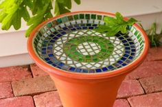 This mosaic bird bath is surprisingly easy to make, and the height of the bowl is perfect for attracting bathing birds.