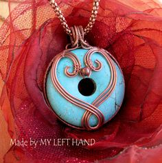 Double sided pendant necklace. Turquoise donut wrapped in solid copper wire with copper necklace.    Pendant size is 2 (5 cm) in diameter.