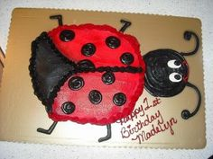 Ladybug shaped birthday cake made out of individual cupcakes! :)
