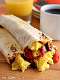 Delicious Breakfast Burritos recipe made with Mexican pulled beef, cheese, and peppers in a flour tortilla. Make these the night before for a quick grab & go breakfast!