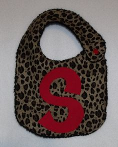 leopard baby girl bib red black custom your CHOICE of initial letter. $9.00, via Etsy.