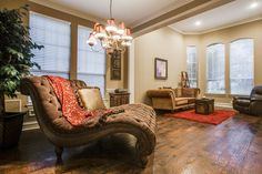Traditional Living Room with Chandelier, Carpet, Cheeta Tufted Fabric Upholstered Chaise, Chair rail, Crown molding