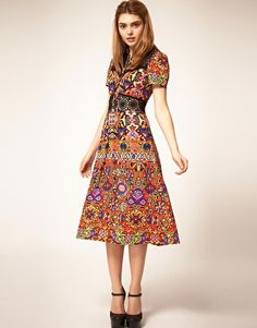 ASOS Midi Dress in Aztec and Lace Print  $81.10  Print midi dress by ASOS Collection. Featuring an all over Aztec print, contrast lace inserts to yoke front and waist, a point collar, half placket front fastening, short length sleeves, a high waistline, with a softly gathered, midi cut skirt.