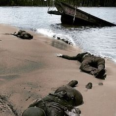 the_ww2_memoirs Pictured above are the rotting corpses,crawling with maggots, of three American soldiers killed by fire from a hidden enemy machine-gun post lie sprawled in the wet sand of Buna Beach, Papua New Guinea, summer, 1942. This image was the first ever photo released to the American public that featured dead American soldiers. It was featured in a issue of the famous LIFE magazine and shocked the American public. Most had been brainwashed to believe that all of the American…