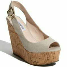 Reduced price!Steve Madden Nude Wissper Wedge Nude Steve Madden Wissper Wedge shoes in good condition. Fabric is nude shimmery canvas, heel is cork. Heel is about 5.5 inches tall. Perfect for casual days as well as events suvh as weddings! Ask any questions you may have about more pictures or measurements! Ask any questions you may have about measurements or more pictures! I welcome all reasonable offers! Also bundle with another item in my closet to save 15% Steve Madden Shoes Platforms