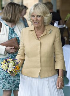 Camilla, Duchess of Cornwall holds a wine glass as she tours the Ancre Hill vineyard on July 9, 2015 in Monmouth, Wales. The Duchess met staff and supporters, and then officially opened the new winery on Rockfield Road.