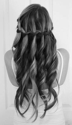 A gorgeous waterfall braid, accentuated by loose curls on beautiful, long hair! Look how beautiful her highlights stand out with this hairstyle.  #braids #inspo #hairgoals #longhair #hairextensions #haircolor #waterfall #getthelook #beauty #beautytips #blackandwhite #photography #style #fashion #diy #braidstyles