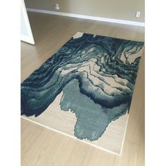 Cool rug yo. Or does it look like someone spilt something on it... Hm.