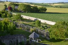 North-east view from the sentries pathway. The vegetable garden is located between the treillis and the stone wall.