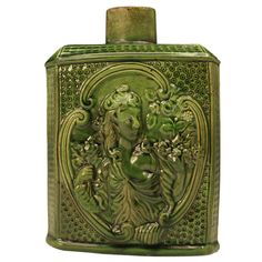 Antique English creamware pottery tea caddy with green glaze.  This exceptionally large caddy is relief moulded in depth with an image of a lady( this image is featured on both sides).  This tea caddy is a very early example with interesting decoration which is often found on Thomas Whieldon's wares. Most caddies produced in this period were significantly smaller. England, circa 1765-1770 - John Howard, Woodstock, UK