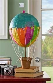 Create this colorful hot air ballon to add a touch of whimsy to any room...or use it as a party centerpiece!