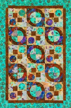 Use hand-dyed batiks and machine piecing and appliquéing in a quilt that combines hard lines and soft curves.