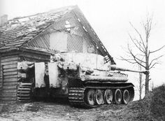 A German Tiger tank, using a farm house for cover. Kharkov, 1943.