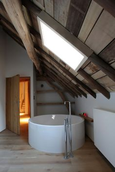 how awesome is this bathroom...love the skylight and wood paneling