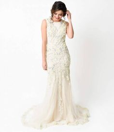 Divinely dotted with pearls, rhinestones and intricately sewn appliqu, this elegant vintage inspired 1930s gown is breathtaking from every angle! Crafted in a delicate layer of tulle over stretch knit lining, with a padded and hand beaded bodice, outfitt