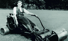 D.J. Squire on an early lawn mower
