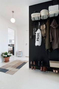 #Minimal #Storage  entryway with a black wall.