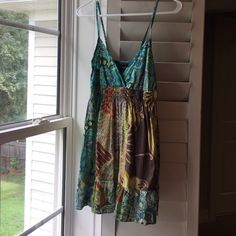 Never worn, tank Cute pattern, comfy and loose, size small but fits like a medium. Tops Tank Tops