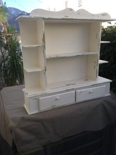 SHABBY SHELF UNIT FIXES TO THE WALL WITH TWO SCREWS  FINISHED IN CREAM CHALK PAINT AND THEN DISTRESSED WOULD SUIT KITCHEN, BATHROOM, DINING AREA OROUTSIDE PATIO  VERY FRENCH COTTAGE VINTAGE LOOK  HEIGHT 24 INCHES WIDTH 25 INCHES DEPTH 6 INCHES  WEIGHT UNPACKED 17 LBS  SHIPPING IS NOT INCLUDED.  ALL SALES ARE FINAL.  THANK YOU FOR VISING MY SHOP