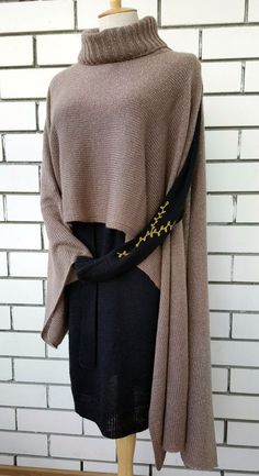 Universal women's poncho. Crocheted poncho with glitter.