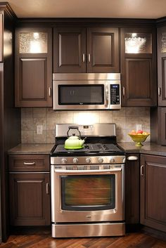 I like the look of these cabinets with those counters and the stainless steel appliances… I'd use a different backsplash though