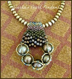 Five  pearls are the focal point for the pendant.  3 strands of Japanese delica beads surrounding each pearl to add interest, and  peyote stitch adds to the overall piece, as well as functions as a beaded bail.  A strand of smaller olive pearls to use as the necklace.