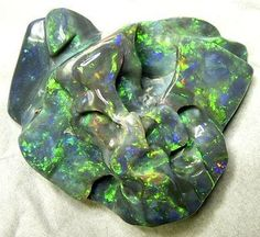 Black Opal...natural formation(?), something I'd surely like to hold.