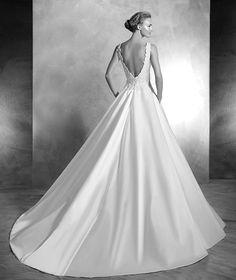 VIGI style: Silk satin princess wedding dress. Bodice with bateau neckline decorated with gemstone embroidery on lace. Deep V-back detail. Satin skirt with side pockets.