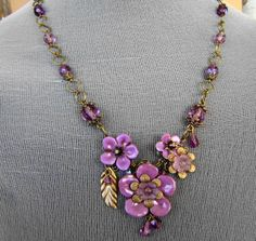 """Dream Bouquet""    This romantic necklace is right for any season!  Polymer clay, brass and lucite flowers along with czech fire-polished glass beads and brass accents are a winning combination.        by Pamela Anger  www.facebook.com/NovegattiDesigns"