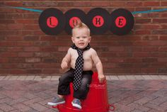 He rocked his First Birthday Photo Session in real baby rocker style. Rocker skull tie and pants, mohawk and record banner props! 1st Birthday Photography for boys. Drummer boy ideas for 1st Birthday Photos. Spike my hawk for photo session. Baby boy photography ideas. Posing for 1st Birthday Smash Cake. Baby smash cake photography. Skull Birthday session. Birthday boy. I'm 1! DigitalMyst Photography of Land O Lakes specializes in children and family photography. #digitalmystphotography