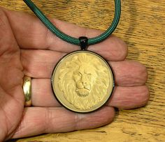 Great Spirit Lion Gold Finish Medallion In Black by GoodSpiritWolf, $39.00