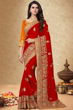 Red silk saree with orange silk blouse, embellished with dori work, resham work and sequins work. Saree with Round Neck, Quarter Sleeve. It comes with unstitch blouse, it can be stitched 32 to 58 sizes. # red #silk # wedding wear #saree #blouse #Andaazfashion #UK