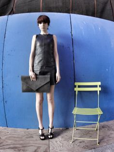 Black envelope leather clutch designed by MORTON + HUDSON in New York City on Taigan